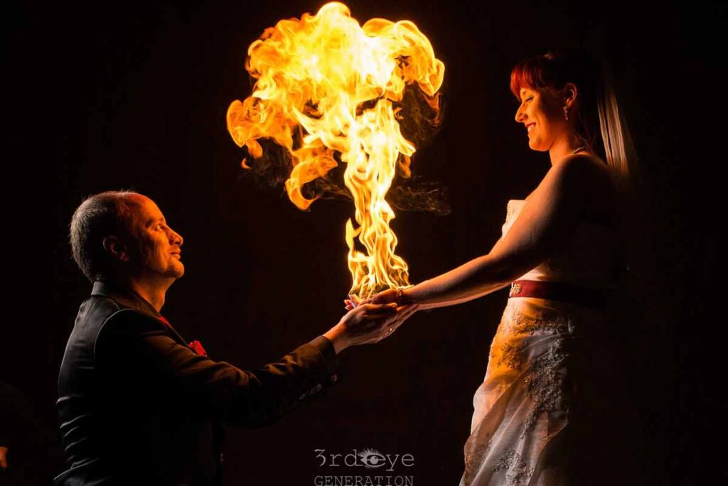 Bridal couple becomes a fire artist