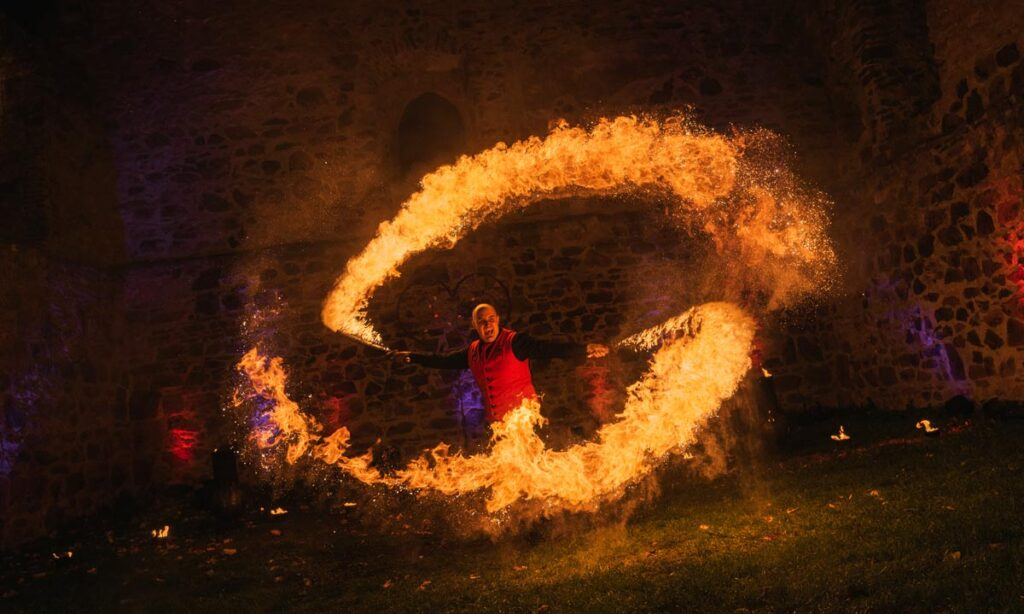 fireartist is doing his fire performance for your event